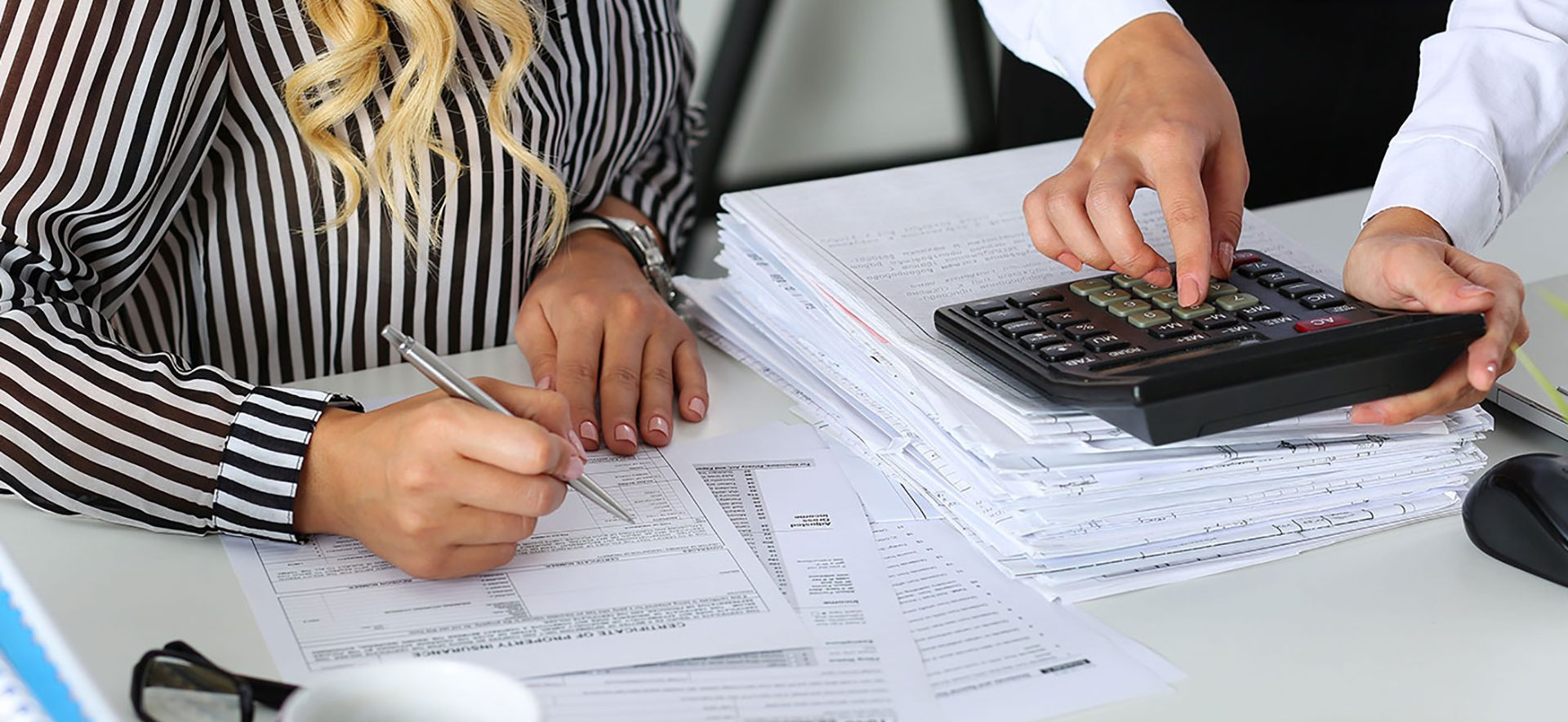 Two people doing accounting work